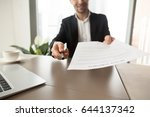 realtor reaching out pen and... | Shutterstock . vector #644137342