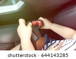 baby boy fasten the seat belt... | Shutterstock . vector #644143285