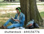 college student studying in park | Shutterstock . vector #644156776