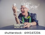 angry  enraged senior woman... | Shutterstock . vector #644165206