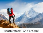 active hiker enjoying the view. ... | Shutterstock . vector #644176402