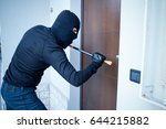 burglar trying to force a door... | Shutterstock . vector #644215882