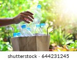 Hand Putting Plastic Bottle In...