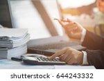 a business woman analyzing... | Shutterstock . vector #644243332