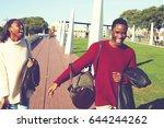 happy stylish two dark skinned... | Shutterstock . vector #644244262