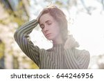 a red haired girl with curls... | Shutterstock . vector #644246956