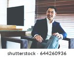 cheerful asian businessman in... | Shutterstock . vector #644260936