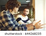 professional male colleagues... | Shutterstock . vector #644268235