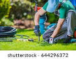 Garden Automatic Watering Systems Installer. Garden System Technician at Work. - stock photo