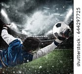 goalkeeper catches the ball in... | Shutterstock . vector #644297725