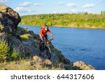 cyclist in red jacket riding... | Shutterstock . vector #644317606