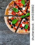homemade pizza with tomato... | Shutterstock . vector #644338882