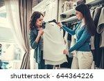 beautiful girls are choosing... | Shutterstock . vector #644364226