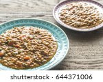 two portions of lentil curry | Shutterstock . vector #644371006