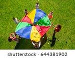 happy kids waving rainbow... | Shutterstock . vector #644381902