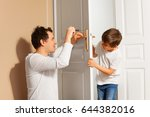 father teaching his son to... | Shutterstock . vector #644382016