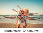 happy family on the beach.... | Shutterstock . vector #644382895