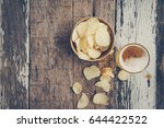 lager beer and snacks on wooden ... | Shutterstock . vector #644422522