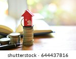 house key on coins saving for...   Shutterstock . vector #644437816