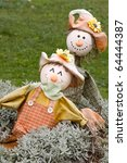 two scarecrows in fall colors... | Shutterstock . vector #64444387