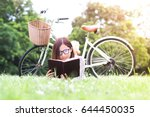 beautiful woman reading a book... | Shutterstock . vector #644450035