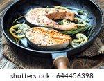 salmon steak  fried with herbs  ...   Shutterstock . vector #644456398