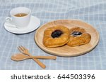 Croissant With Tea On Blue...