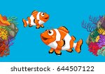 two clownfish swimming in ocean ... | Shutterstock .eps vector #644507122