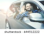 image of afro man driving a car ... | Shutterstock . vector #644512222