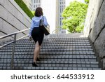 Young Woman Going Up The Stair...