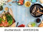 frame of shrimp  fish grilled ... | Shutterstock . vector #644534146