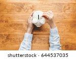 woman holding a white piggy... | Shutterstock . vector #644537035
