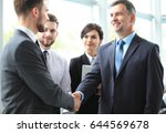 business people shaking hands ... | Shutterstock . vector #644569678