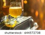 glass of pale ale beer standing ... | Shutterstock . vector #644572738