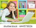 teenage girl using a laptop | Shutterstock . vector #644573026