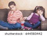 bored kids watching tv | Shutterstock . vector #644583442