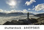 man standing on the stone above ... | Shutterstock . vector #644595805