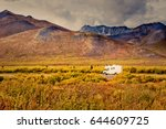 Dempster Highway Adventure, RV in fall color tundra landscape of Tombstone Territorial Park, Ogilvie Mountains, Yukon Territory, Canada