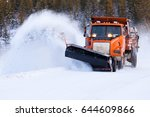 Snow Plow Truck Clearing Road...