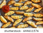 baked potato wedges with spices ... | Shutterstock . vector #644611576