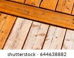wooden deck boards partially... | Shutterstock . vector #644638882