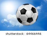 Football with motion against blue sky. - stock photo