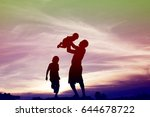 father took the baby learn to... | Shutterstock . vector #644678722