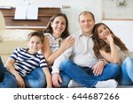 portrait of young happy family... | Shutterstock . vector #644687266