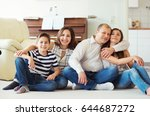 portrait of young happy family... | Shutterstock . vector #644687272