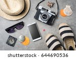 travel accessories on gray... | Shutterstock . vector #644690536
