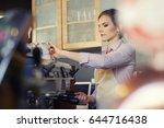 female barista serving coffee... | Shutterstock . vector #644716438