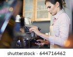 female barista preparing coffee ... | Shutterstock . vector #644716462