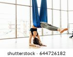 young girl do fly yoga and... | Shutterstock . vector #644726182