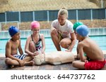 female lifeguard assisting... | Shutterstock . vector #644737762